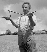 1942 George Casely uses hazel twig to attempt to find water on the land around his Devon farm